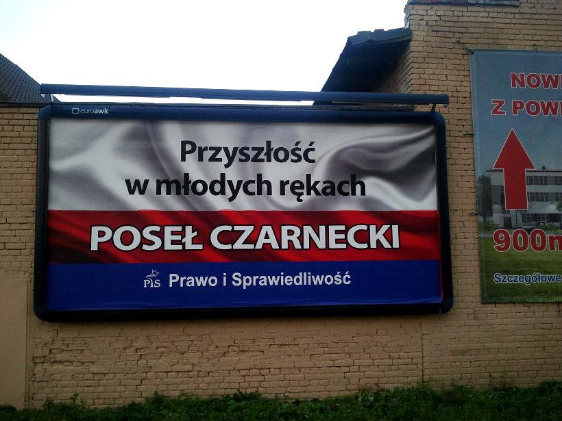 reklama przy płocie sąsiada